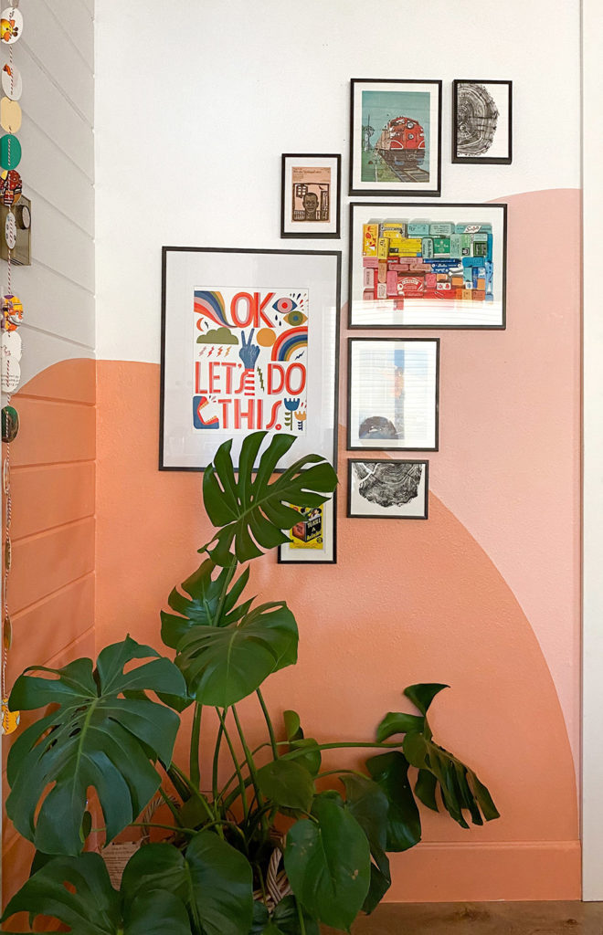 Colorful Gallery Wall with a Warm, Sunset Mural by Racheal Jackson of Banyan Bridges