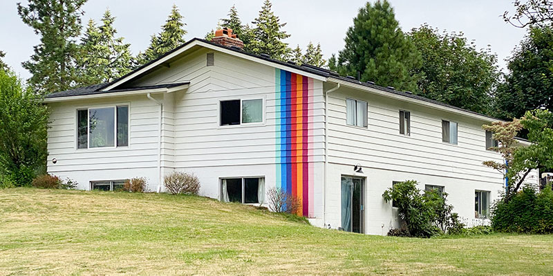 Bold-colorful-striped-house-exterior-by-banyan-bridges